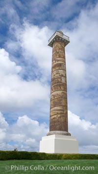 The Astoria Column rises 125 feet above Coxcomb Hill, site of the first permanent American Settlement west of the Rockies, itself 600 feet above Astoria.  It was erected in 1926 and has been listed in the National Register of Historic Places since 1974.  The column displays 14 scenes commemorating important events in the history of Astoria in cronological order. An interior 164-step spiral staircase leads to the top of a viewing platform with spectacular views. Astoria, Oregon, USA, natural history stock photograph, photo id 19444