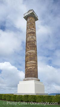 The Astoria Column rises 125 feet above Coxcomb Hill, site of the first permanent American Settlement west of the Rockies, itself 600 feet above Astoria.  It was erected in 1926 and has been listed in the National Register of Historic Places since 1974.  The column displays 14 scenes commemorating important events in the history of Astoria in cronological order. An interior 164-step spiral staircase leads to the top of a viewing platform with spectacular views. Astoria, Oregon, USA, natural history stock photograph, photo id 19445