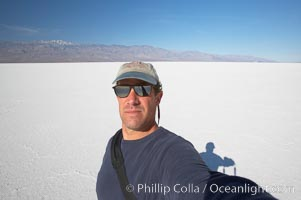 Self portrait on salt pan, Death Valley National Park, California