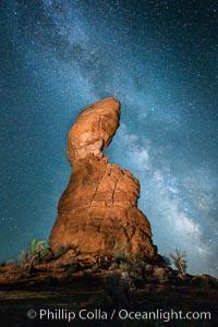 Balanced Rock and Milky Way stars at night, Arches National Park, Utah