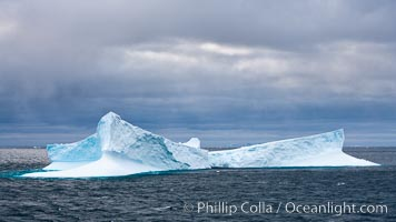 Image 24779, Iceberg, ocean, light and clouds.  Light plays over icebergs and the ocean near Coronation Island. Coronation Island, South Orkney Islands, Southern Ocean, Phillip Colla, all rights reserved worldwide.   Keywords: berg:british antarctic territory:cold:coronation island:frozen:ice:ice berg:iceberg:landscape:ocean:oceans:outdoors:outside:scene:scenery:sea:seascape:south orkney islands:south orkneys:southern ocean:united kingdom:view:water.