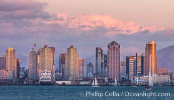 San Diego city skyline, dusk, clearing storm clouds