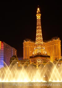 Image 20580, The Bellagio Hotel fountains light up the reflection pool as the half-scale replica of the Eiffel Tower at the Paris Hotel in Las Vegas rises above them, at night. Nevada, USA, Phillip Colla, all rights reserved worldwide. Keywords: bellagio fountains, las vegas, las vegas at night, nevada, usa.