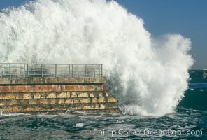 Winter storm wave pounds the protective seawall at the Children's Pool (Casa Cove) in La Jolla, Childrens Pool