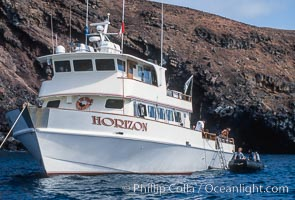 Boat Horizon loading diver into skiff. Guadalupe Island (Isla Guadalupe), Baja California, Mexico, natural history stock photograph, photo id 03716
