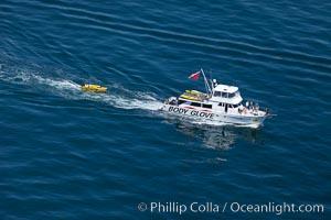 Body Glove boat motoring over the ocean, Redondo Beach, California