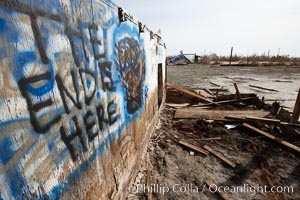Bombay Beach, lies alongside and below the flood level of the Salton Sea, so that it floods occasionally when the Salton Sea rises.  A part of Bombay Beach is composed of derelict old trailer homes, shacks and wharfs, slowly sinking in the mud and salt. Salton Sea, Imperial County, California, USA, natural history stock photograph, photo id 22489