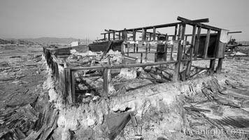 Bombay Beach, lies alongside and below the flood level of the Salton Sea, so that it floods occasionally when the Salton Sea rises.  A part of Bombay Beach is composed of derelict old trailer homes, shacks and wharfs, slowly sinking in the mud and salt. Salton Sea, Imperial County, California, USA, natural history stock photograph, photo id 22493