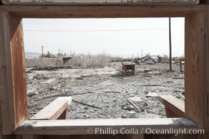 Bombay Beach, lies alongside and below the flood level of the Salton Sea, so that it floods occasionally when the Salton Sea rises.  A part of Bombay Beach is composed of derelict old trailer homes, shacks and wharfs, slowly sinking in the mud and salt. Salton Sea, Imperial County, California, USA, natural history stock photograph, photo id 22496