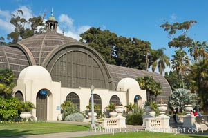 The Botanical Building in Balboa Park, San Diego.  The Botanical Building, at 250 feet long by 75 feet wide and 60 feet tall, was the largest wood lath structure in the world when it was built in 1915 for the Panama-California Exposition. The Botanical Building, located on the Prado, west of the Museum of Art, contains about 2,100 permanent tropical plants along with changing seasonal flowers. The Lily Pond, just south of the Botanical Building, is an eloquent example of the use of reflecting pools to enhance architecture. The 193 by 43 foot pond and smaller companion pool were originally referred to as Las Lagunas de las Flores (The Lakes of the Flowers) and were designed as aquatic gardens. The pools contain exotic water lilies and lotus which bloom spring through fall.  Balboa Park, San Diego. USA, natural history stock photograph, photo id 14579