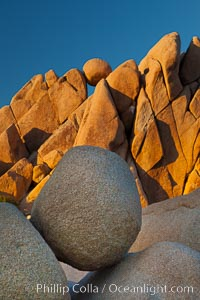 Boulders and sunset in Joshua Tree National Park.  The warm sunlight gently lights unusual boulder formations at Jumbo Rocks in Joshua Tree National Park, California