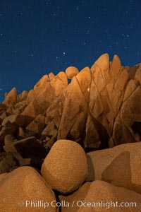 Image 27716, Boulders and stars, moonlight in Joshua Tree National Park. The moon gently lights unusual boulder formations at Jumbo Rocks in Joshua Tree National Park, California. Joshua Tree National Park, California, USA, Phillip Colla, all rights reserved worldwide. Keywords: astrophotography, boulder, california, desert, dusk, evening, joshua tree, joshua tree national park, landscape, landscape astrophotography, moon light, national park, night, outdoors, outside, rock, scene, scenery, scenic, sky, southwest, star field, stars.