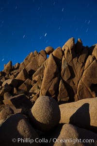 Boulders and stars, moonlight in Joshua Tree National Park. The moon gently lights unusual boulder formations at Jumbo Rocks in Joshua Tree National Park, California