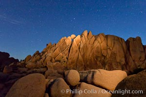 Boulders and stars, moonlight in Joshua Tree National Park. The moon gently lights unusual boulder formations at Jumbo Rocks in Joshua Tree National Park, California. Joshua Tree National Park, California, USA, natural history stock photograph, photo id 27718