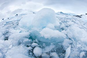 Brash ice and pack ice in Antarctica.  Brash ices fills the ocean waters of Cierva Cove on the Antarctic Peninsula.  The ice is a mix of sea ice that has floated near shore on the tide and chunks of ice that have fallen into the water from nearby land-bound glaciers