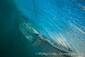 Breaking wave, morning, barrel shaped surf, California