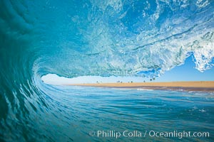 Breaking wave, morning, barrel shaped surf, California
