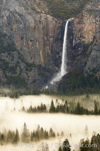 Bridalveil Falls and misty Yosemite Valley, Yosemite National Park, California