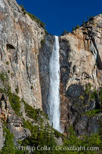 Bridalveil Falls in Yosemite drops 620 feet (188 m) from a hanging valley to the floor of Yosemite Valley, Yosemite National Park, California