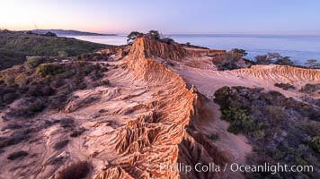 Broken Hill in soft pre-dawn light, overlooking the Pacific Ocean and Torrey Pines State Reserve. La Jolla and Mount Soledad in the distance, San Diego, California
