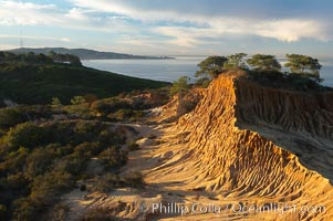 Broken Hill with La Jolla and the Pacific Ocean in the distance.  Broken Hill is an ancient, compacted sand dune that was uplifted to its present location and is now eroding, Torrey Pines State Reserve, San Diego, California