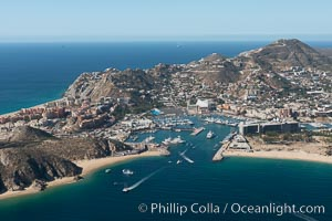 Cabo San Lucas, marina and downtown, showing extensive development and many resorts and sport fishing boats