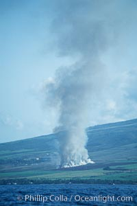 West Maui and smoke from burning cut sugar cane.  Cane fields are often burned to clear cane cuttings, which produces huge amounts of smoke and ash