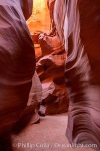 Canyon X, a spectacular slot canyon near Page, Arizona.  Slot canyons are formed when water and wind erode a cut through a (usually sandstone) mesa, producing a very narrow passage that may be as slim as a few feet and a hundred feet or more in height