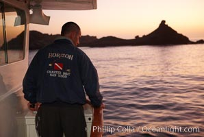 Captain Greg Grivetto, anchoring boat Horizon at sunrise at China Hat Point, San Clemente Island