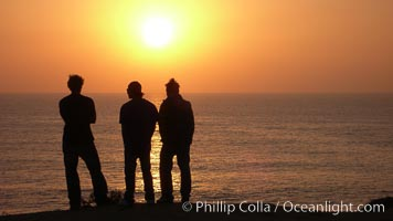 Surf check.  Three guys check the surf from atop a bluff overlooking the waves at the end of the day, at sunset, north of South Carlsbad State Beach. Carlsbad, California, USA, natural history stock photograph, photo id 19808