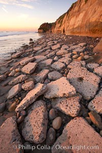 """Remains of the old historic """"Coast Highway 101"""", undermined as the bluff upon which it was built eroded away, now broken into pieces of concrete and asphalt blocks and fallen down the sea cliffs, lying on the beach. Carlsbad, California, USA, natural history stock photograph, photo id 22193"""