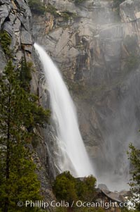 Lower Cascade Creek Falls drops 300 feet just off highway 140 near Yosemite Valley, Yosemite National Park, California