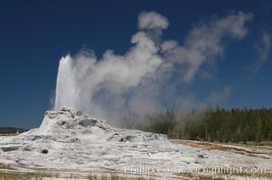 Castle Geyser erupts, reaching 60 to 90 feet in height and lasting 20 minutes.  While Castle Geyser has a 12 foot sinter cone that took 5,000 to 15,000 years to form, it is in fact situated atop geyserite terraces that themselves may have taken 200,000 years to form, making it likely the oldest active geyser in the park. Upper Geyser Basin, Yellowstone National Park, Wyoming
