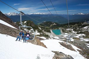 Visitors enjoy a summer ride up the top chair lift at Whistler Mountain