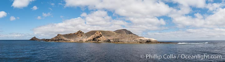 San Clemente Island, south end showing China Hat (Balanced Rock) and Pyramid Head, near Pyramic Cove, storm clouds. Panoramic photo
