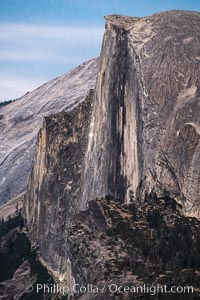 Climbers' lights visible at dusk on Half Dome, Yosemite National Park