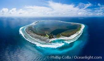 Aerial panorama of Clipperton Island, showing the entire atoll.  Clipperton Island, a minor territory of France also known as Ile de la Passion, is a small (2.3 sq mi) but  spectacular coral atoll in the eastern Pacific. By permit HC / 1485 / CAB (France)., natural history stock photograph, photo id 32835