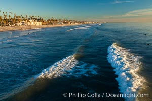 The coast of Oceanside California, waves and surfers, beach houses, just before sunset, winter, looking south, Oceanside Pier