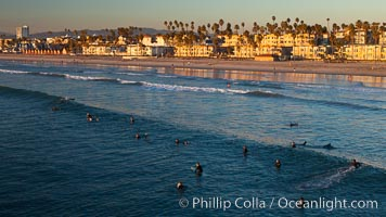 The coast of Oceanside California, waves and surfers, beach houses, just before sunset, winter, looking north, Oceanside Pier