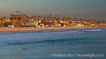 The coast of Oceanside California, waves and surfers, beach houses, just before sunset, winter, looking south. Oceanside Pier, USA, natural history stock photograph, photo id 27606