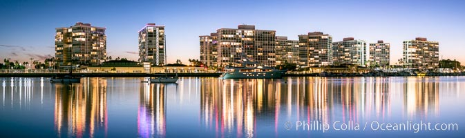 Coronado Shores condos reflected in Glorietta Bay, San Diego Bay, evening