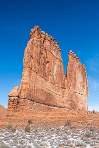 Courthouse Towers, narrow sandstone fins towering above the surrounding flatlands, Arches National Park, Utah