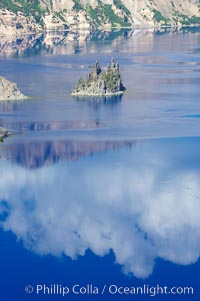 Phantom Ship, Crater Lake. Crater Lake is the six-mile wide lake inside the collapsed caldera of volcanic Mount Mazama, Crater Lake National Park, Oregon