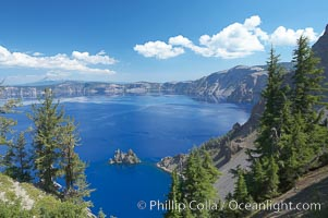 Crater Lake and Phantom Ship. Crater Lake is the six-mile wide lake inside the collapsed caldera of volcanic Mount Mazama, Crater Lake National Park, Oregon