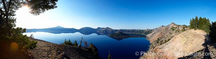 Panorama of Crater Lake at sunrise.  Crater Lake is the six-mile wide lake inside the collapsed caldera of volcanic Mount Mazama. Crater Lake is the deepest lake in the United States and the seventh-deepest in the world. Its maximum recorded depth is 1996 feet (608m). It lies at an altitude of 6178 feet (1880m), Crater Lake National Park