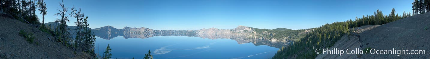 Panorama of Crater Lake, early morning.  Crater Lake is the six-mile wide lake inside the collapsed caldera of volcanic Mount Mazama. Crater Lake is the deepest lake in the United States and the seventh-deepest in the world. Its maximum recorded depth is 1996 feet (608m). It lies at an altitude of 6178 feet (1880m). Crater Lake National Park, Oregon, USA, natural history stock photograph, photo id 19115