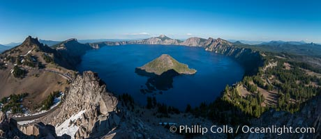 Image 28633, Panorama of Crater Lake from Watchman Lookout Station, panoramic picture. The Watchman Lookout Station No. 168 is one of two fire lookout towers in Crater Lake National Park in southern Oregon. For many years, National Park Service personnel used the lookout to watch for wildfires during the summer months. It is also a popular hiking destination because it offers an excellent view of Crater Lake and the surrounding area. Crater Lake National Park, Oregon, USA, Phillip Colla, all rights reserved worldwide. Keywords: crater, crater lake, crater lake national park, fire lookout, fire lookout tower, lake, landscape, national park, national parks, nature, oregon, outdoors, outside, panorama, panoramic photo, scene, scenery, scenic, usa, watchman lookout station, watchman point, wildfire, wizard island.