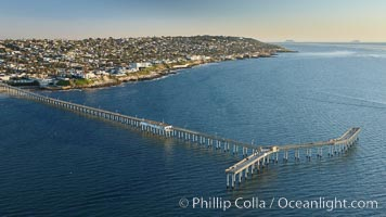 Ocean Beach Pier, also known as the OB Pier or Ocean Beach Municipal Pier, is the longest concrete pier on the West Coast measuring 1971 feet (601 m) long.  Sunset Cliffs and Point Loma extend off to the south. San Diego, California, USA, natural history stock photograph, photo id 22304
