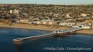 Crystal Pier, 872 feet long and built in 1925, extends out into the Pacific Ocean from the town of Pacific Beach, San Diego, California