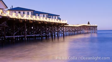 The Crystal Pier and Pacific Ocean at sunrise, dawn, waves blur as they crash upon the sand.  Crystal Pier, 872 feet long and built in 1925, extends out into the Pacific Ocean from the town of Pacific Beach. California, USA, natural history stock photograph, photo id 27240